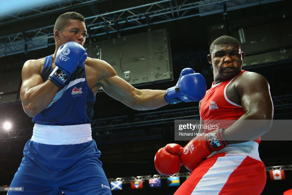 Joseph Joyce of England (blue) in action against Keddy Agnes of Seychelles in the Men's Super Heavy +91kg preliminaries at Scottish Exhibition And Conference Centre during day two of the Glasgow 2014 Commonwealth Games on July 25, 2014 in Glasgow, United Kingdom.