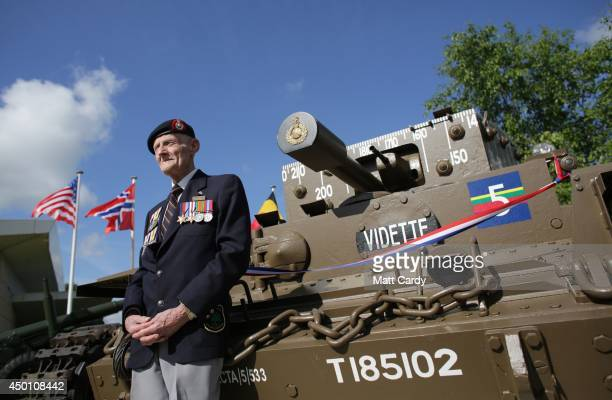 Joseph Kellsey who was in the Royal Marines on Sword Beach on DDay stands in front of a Centaur tank as they attend a service at Pegasus Bridge...