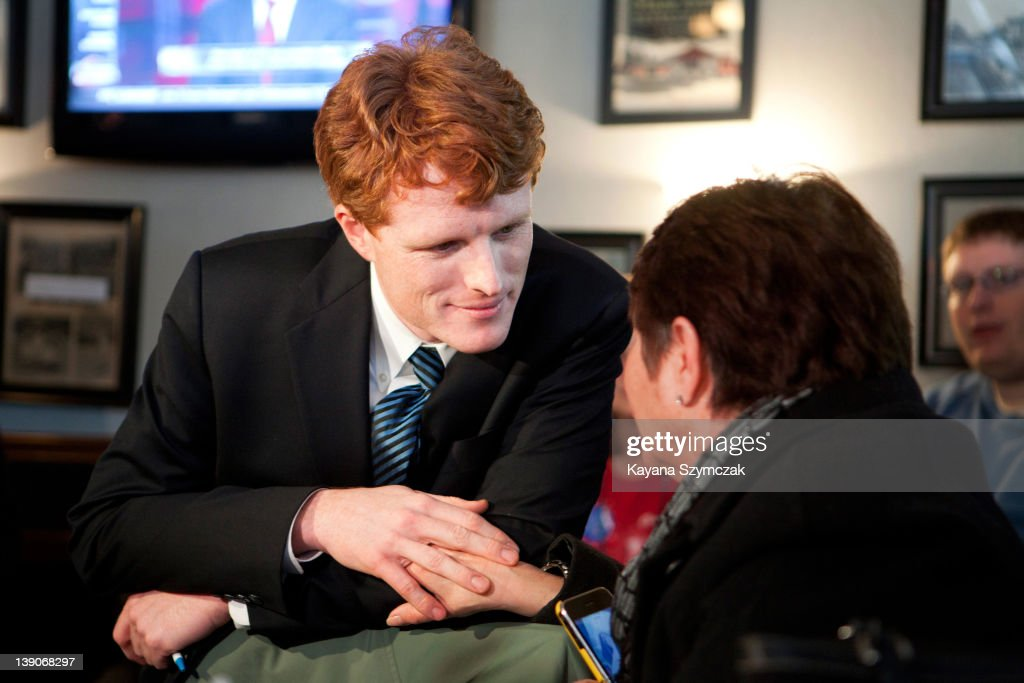 Joseph Kennedy III (L) talks with a person while visiting Morin's Hometown Bar and Grille on February 16, 2012 in Attleboro, Massachusetts. Kennedy officially announced that he is running for U.S Congress for Massachusetts in a video on his website February 12, hoping to fill the seat of retiring U.S. Rep. Barney Frank (D-MA).