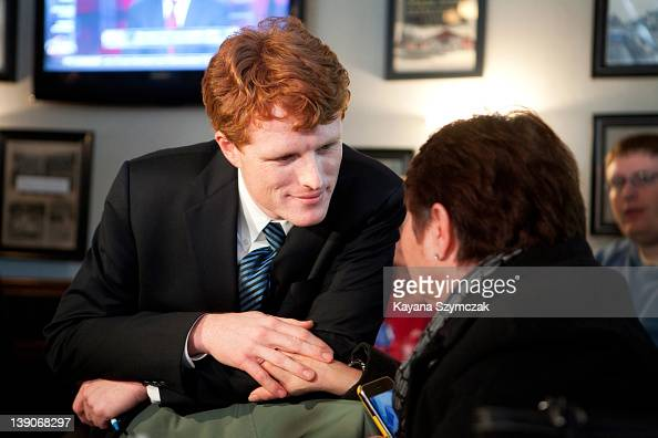 Joseph Kennedy III talks with a person while visiting Morin's Hometown Bar and Grille on February 16 2012 in Attleboro Massachusetts Kennedy...