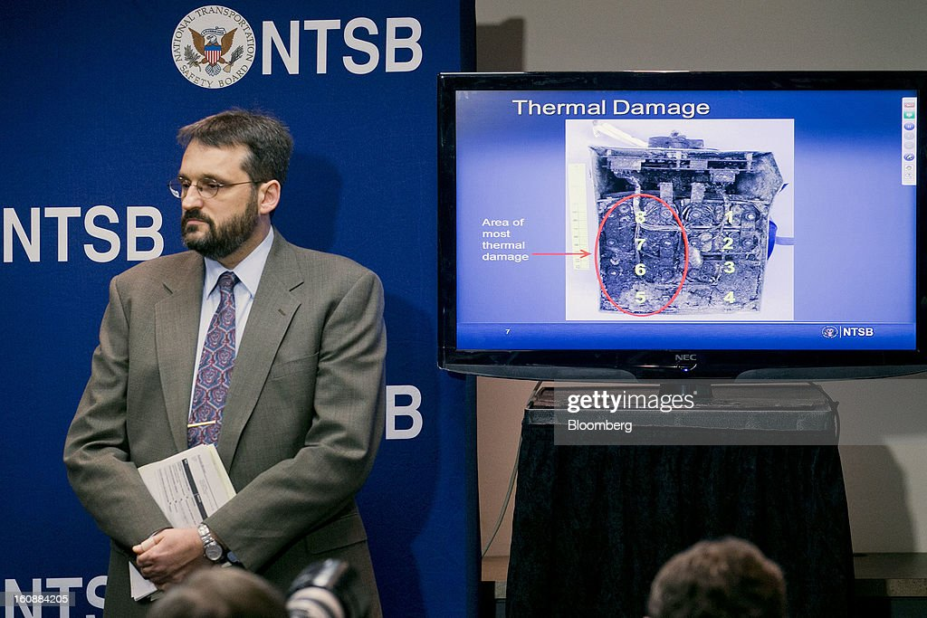 Joseph Kolly, director of research and engineering with the National Transportation Safety Board (NTSB), stands next to a television displaying a damaged battery from a Japan Airlines Co. (JAL) Boeing Co. 787 Dreamliner during a news conference in Washington, D.C., U.S., on Thursday, Feb. 7, 2013. The top U.S. transportation safety investigator today questioned the adequacy of tests that prompted U.S. regulators to allow Boeing Co. to use lithium-ion batteries on the now-grounded 787 Dreamliner. Photographer: Andrew Harrer/Bloomberg via Getty Images