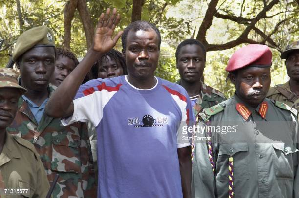 Joseph Kony the leader of the Ugandan rebel group the Lord's Resistance Army is flanked by his LRA deputies including senior commander Okot Odiambo...