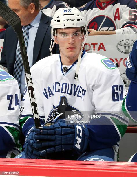 Joseph LaBate of the Vancouver Canucks looks on from the bench prior to puck drop against the Winnipeg Jets at the MTS Centre on March 26 2017 in...