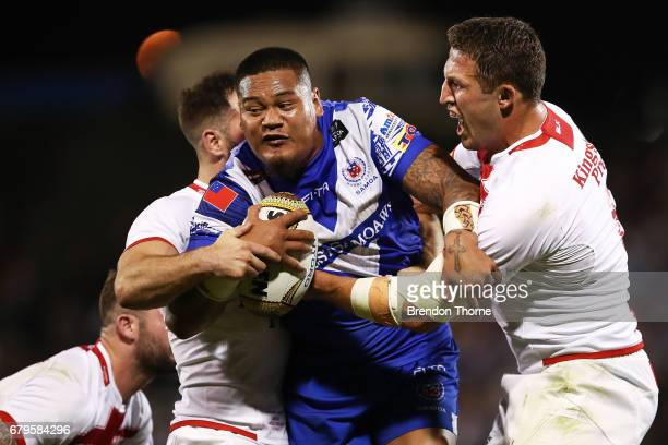 Joseph Leilua of Samoa is tackled by the England defence during the 2017 Pacific Test Invitational match between England and Samoa at Campbelltown...