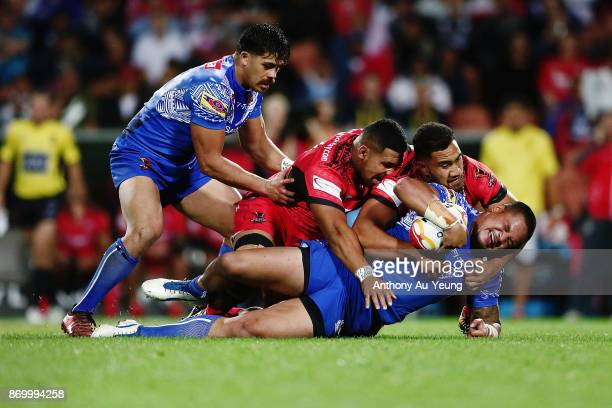 Joseph Leilua of Samoa is tackled during the 2017 Rugby League World Cup match between Samoa and Tonga at Waikato Stadium on November 4 2017 in...