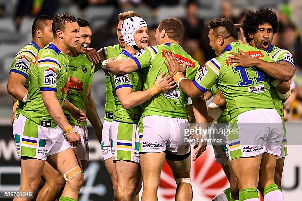 Joseph Leilua of the Raiders celebrates scoring a try with team mates during the round 23 NRL match between the Canberra Raiders and the Melbourne...