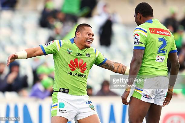 Joseph Leilua of the Raiders celebrates with team mate Edrick Lee after scoring a try during the round 20 NRL match between the Canberra Raiders and...