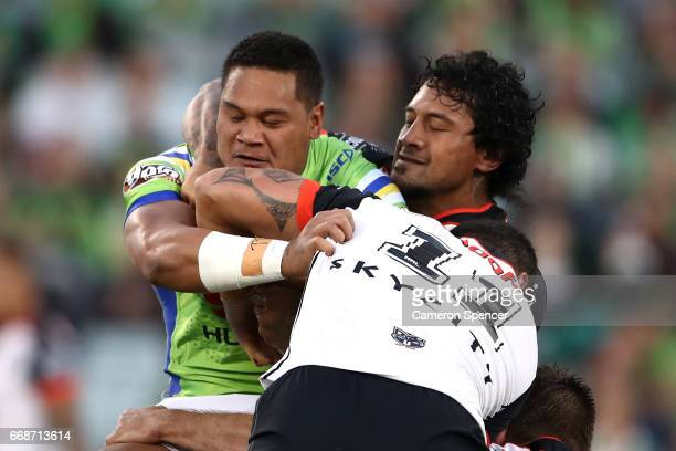 Joseph Leilua of the Raiders is tackled between the Canberra Raiders and the New Zealand Warriors at GIO Stadium on April 15 2017 in Canberra...