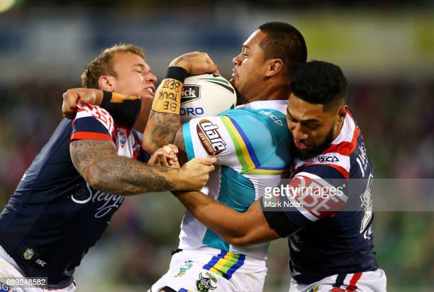 Joseph Leilua of the Raiders is tackled during the round 12 NRL match between the Canberra Raiders and the Sydney Roostrers at GIO Stadium on May 28...
