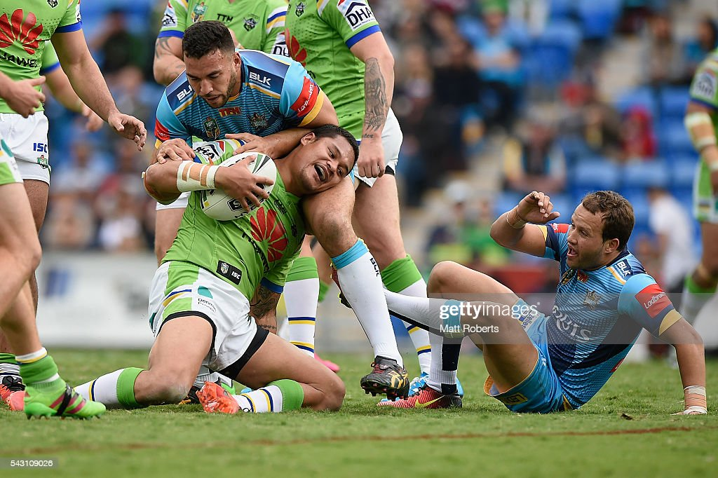 Joseph Leilua of the Raiders is tackled during the round 16 NRL match between the Gold Coast Titans and the Canberra Raiders at Cbus Super Stadium on June 26, 2016 in Gold Coast, Australia.