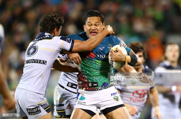 Joseph Leilua of the Raiders is tackled during the round 17 NRL match between the Canberra Raiders and the North Queensland Cowboys at GIO Stadium on...