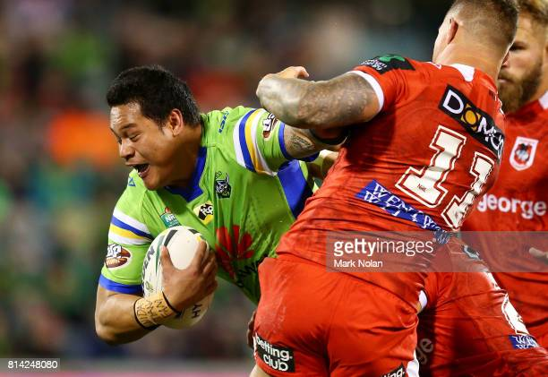 Joseph Leilua of the Raiders is tackled during the round 19 NRL match between the Canberra Raiders and the St George Illawarra Dragons at GIO Stadium...