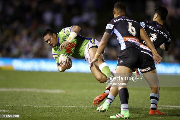 Joseph Leilua of the Raiders is tackled during the round 22 NRL match between the Cronulla Sharks and the Canberra Raiders at Southern Cross Group...