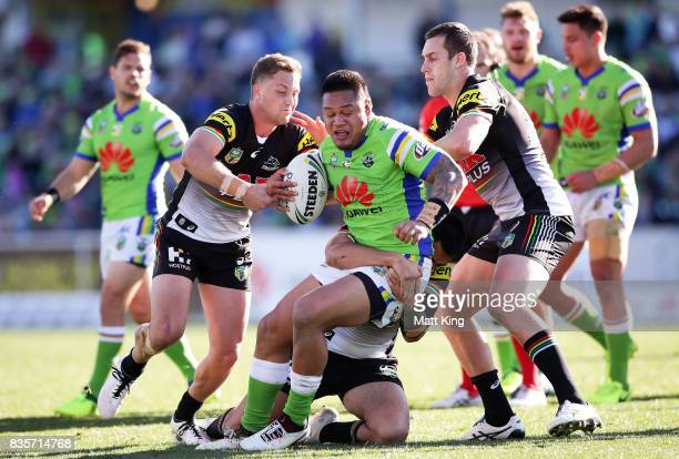Joseph Leilua of the Raiders is tackled during the round 24 NRL match between the Canberra Raiders and the Penrith Panthers at GIO Stadium on August...