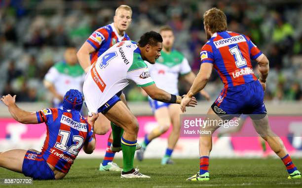 Joseph Leilua of the Raiders is tackled during the round 25 NRL match between the Canberra Raiders and the Newcastle Knights at GIO Stadium on August...