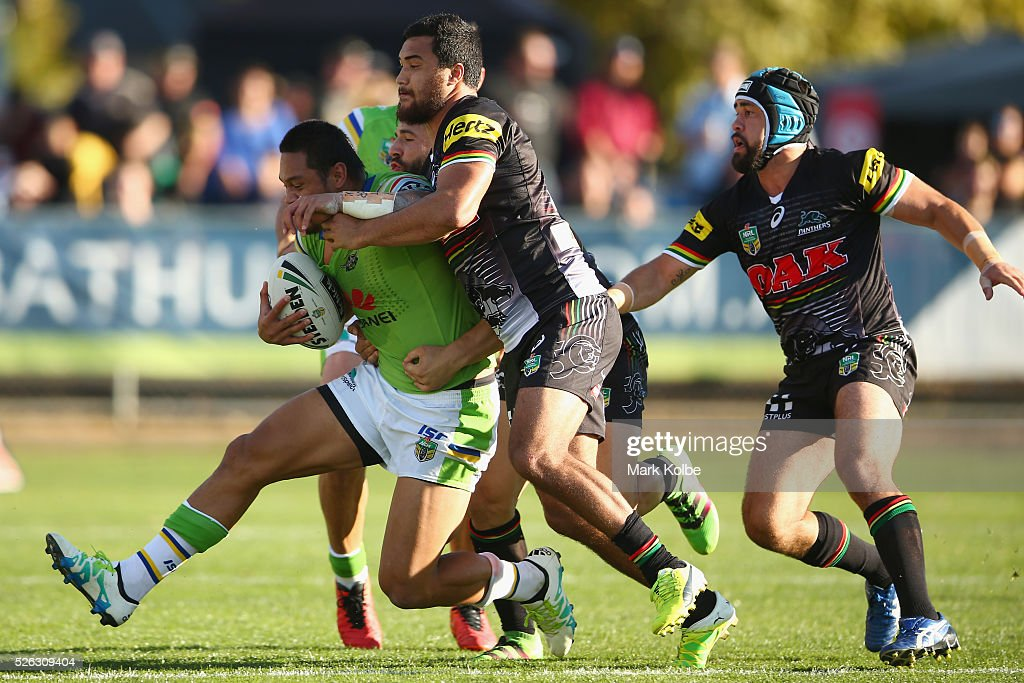 Joseph Leilua of the Raiders is tackled during the round nine NRL match between the Penrith Panthers and the Canberra Raiders at Carrington Park on April 30, 2016 in Bathurst, Australia.