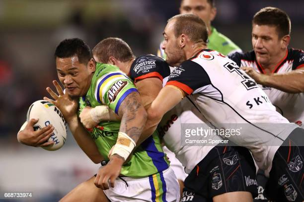 Joseph Leilua of the Raiders is tackled during the round seven NRL match between the Canberra Raiders and the New Zealand Warriors at GIO Stadium on...