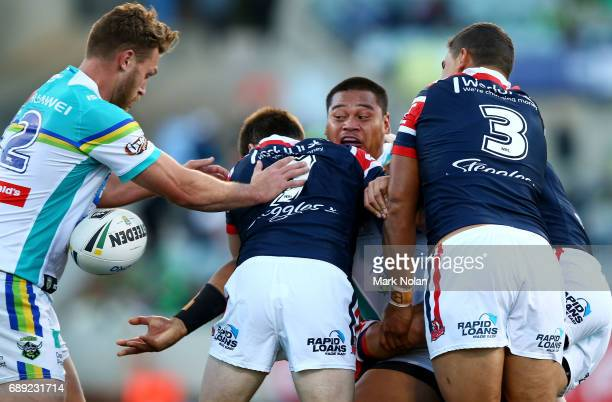 Joseph Leilua of the Raiders offloads during the round 12 NRL match between the Canberra Raiders and the Sydney Roostrers at GIO Stadium on May 28...