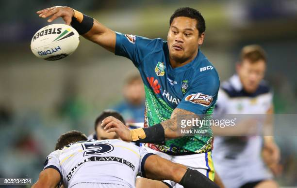 Joseph Leilua of the Raiders offloads during the round 17 NRL match between the Canberra Raiders and the North Queensland Cowboys at GIO Stadium on...