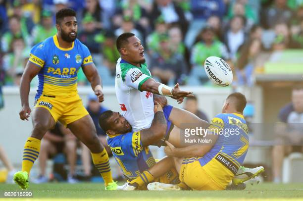 Joseph Leilua of the Raiders offloads during the round five NRL match between the Canberra Raiders and the Parramatta Eels at GIO Stadium on April 1...