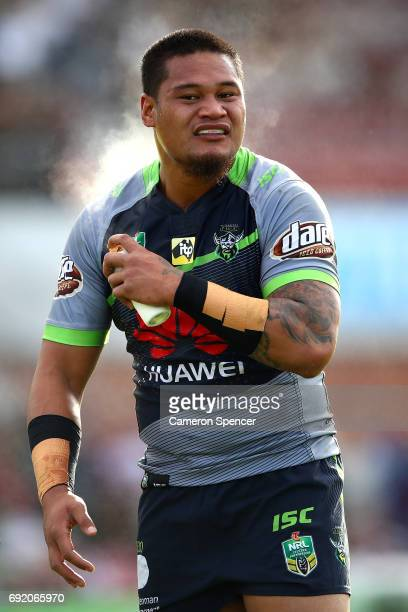 Joseph Leilua of the Raiders sprays himself during the round 13 NRL match between the Manly Sea Eagles and the Canberra Raiders at Lottoland on June...