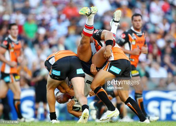 Joseph Leilua of the Roosters is dumped by the Tigers defence during the round four NRL match between the Sydney Roosters and the Wests Tigers at the...