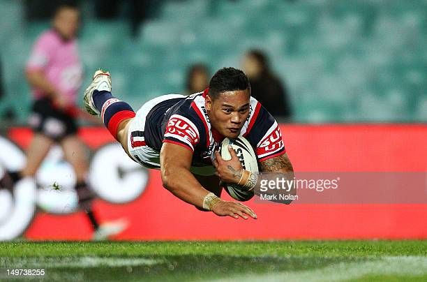 Joseph Leilua of the Roosters scores during the round 22 NRL match between the Sydney Roosters and the St George Illawarra Dragons at Allianz Stadium...