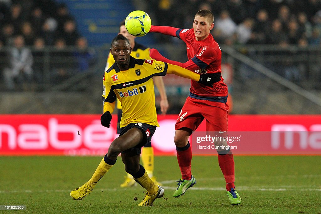 Joseph Lopy of FC Sochaux-Montbeliard and Marco Verratti of Paris Saint-Germain FC compete for the ball during the French League 1 football match between FC Sochaux-Montbeliard and Paris Saint-Germain FC at Stade Auguste Bonal on February 17, 2013 in Montbeliard, France.