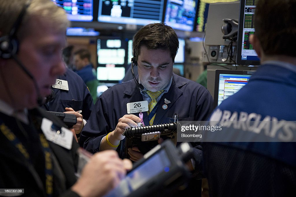 Joseph M. Lawler of Illlustro Trading LLC works at the New York Stock Exchange (NYSE) in New York, U.S., on Monday, Jan. 28, 2013. U.S. stocks fell, following the longest rally for the Standard & Poor's 500 Index since 2004, after a report showed pending home sales declined. Photographer: Scott Eells/Bloomberg via Getty Images