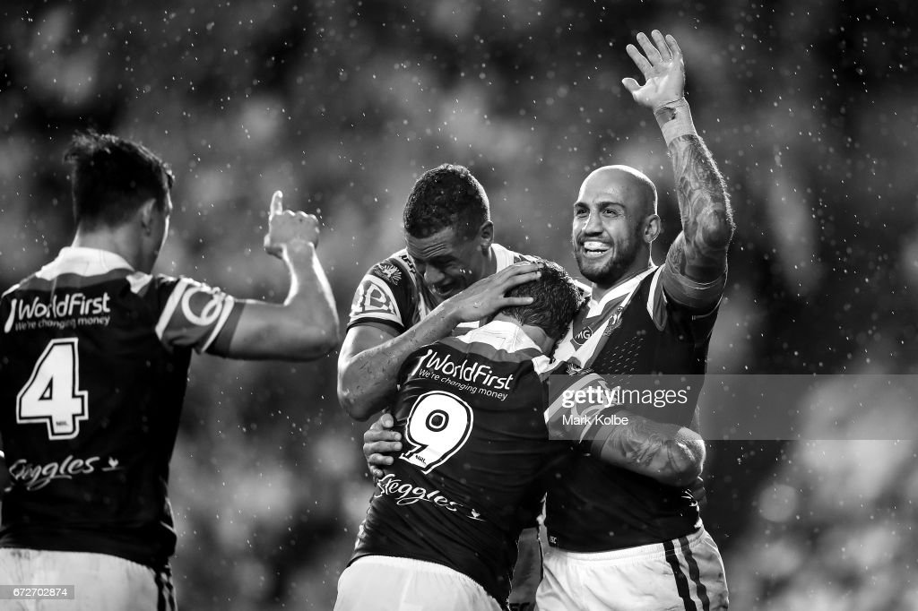 Joseph Manu, Kane Evans and Jake Friend of the Roosters congratulate Blake Ferguson of the Roosters as he celebrates scoring a try during the round eight NRL match between the Sydney Roosters and the St George Illawarra Dragons at Allianz Stadium on April 25, 2017 in Sydney, Australia.