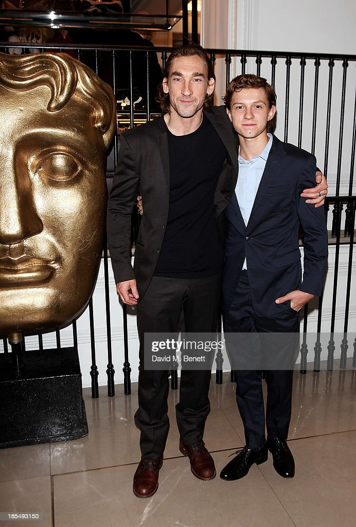 Joseph Mawle (L) and Breakthrough Brit <a gi-track='captionPersonalityLinkClicked' href=/galleries/search?phrase=Tom+Holland+-+Actor&family=editorial&specificpeople=9843230 ng-click='$event.stopPropagation()'>Tom Holland</a> attend the BAFTA 'Breakthrough Brits' event at Burberry 121 Regent Street, London on October 21, 2013 in London, United Kingdom.