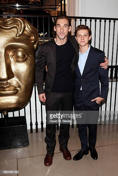 Joseph Mawle and Breakthrough Brit Tom Holland attend the BAFTA 'Breakthrough Brits' event at Burberry 121 Regent Street London on October 21 2013 in...