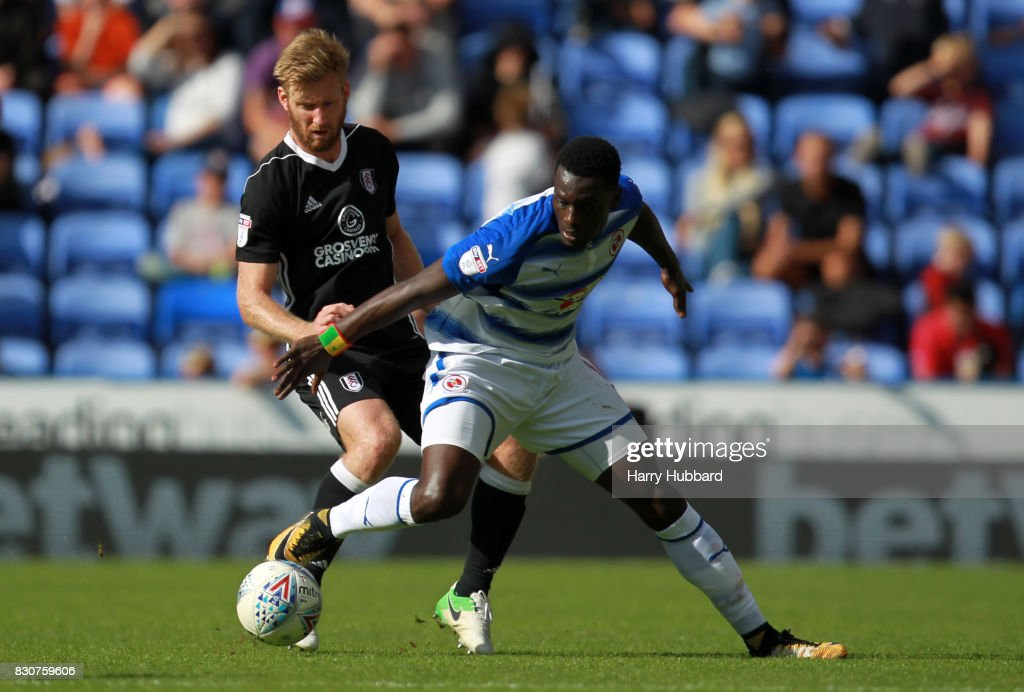 Joseph Mendes of Reading and Tim Ream of Fulham in action during the Sky Bet Championship match between Reading and Fulham at Madejski Stadium on August 12, 2017 in Reading, England.