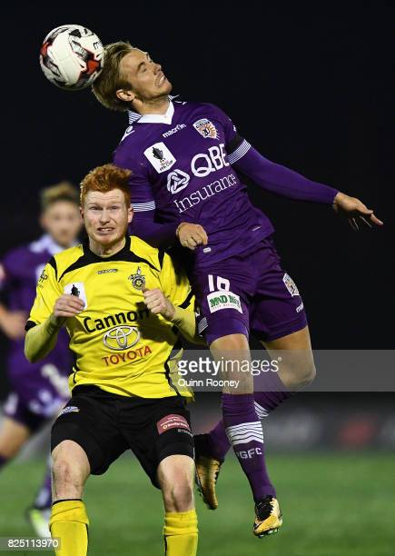 Joseph Mills of Glory heads the ball over the top of Sean Ellis of United during the FFA Cup round of 32 match between Heidelberg United FC and Perth...
