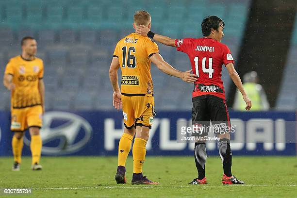 Joseph Mills of the Glory and Jumpei Kusukami of the Wanderers congratulate each other at full time during the round 13 ALeague match between the...