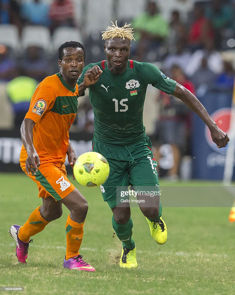 AFRICA - JANUARY 29, Joseph Musonda from Zambia (L) and Aristide Bance from Burkina Faso in action during the 2013 Orange African Cup of Nations match between Burkina Faso and Zambia from Mbombela Stadium on January 29, 2013 in Nelspruit, South Africa.