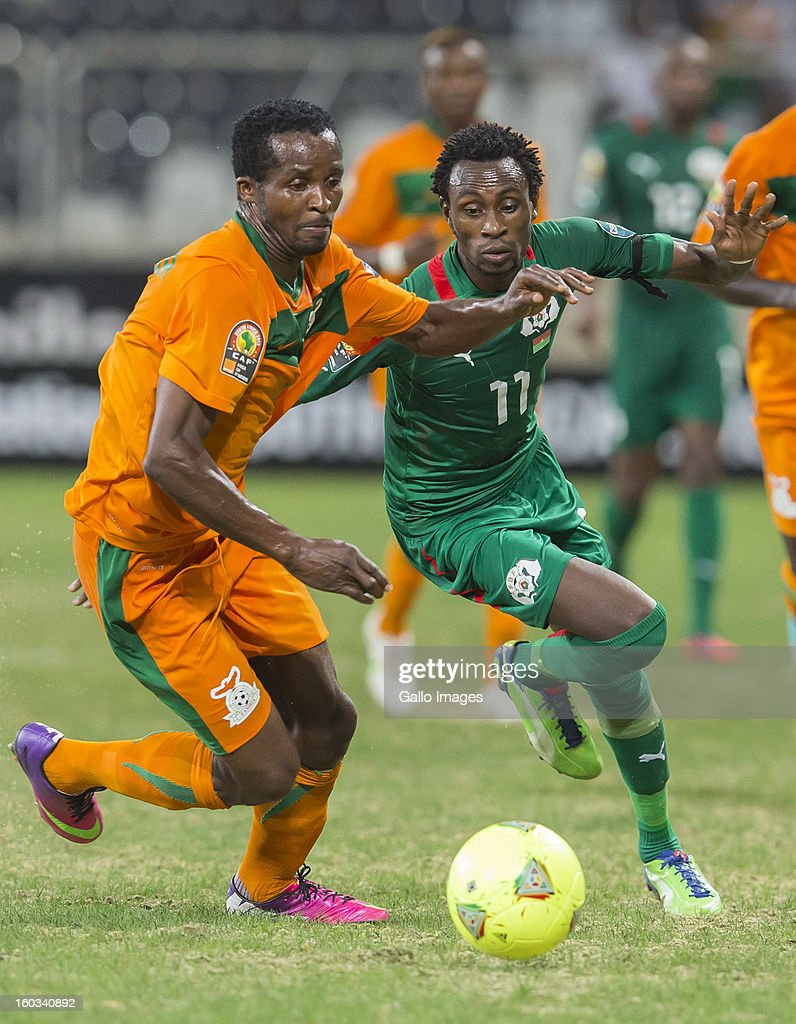 AFRICA - JANUARY 29, Joseph Musonda from Zambia (L) and B Y Jonathan Pitroipa from Burkina Faso in action during the 2013 Orange African Cup of Nations match between Burkina Faso and Zambia from Mbombela Stadium on January 29, 2013 in Nelspruit, South Africa.