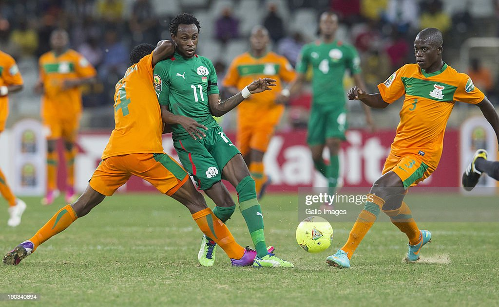 AFRICA - JANUARY 29, Joseph Musonda from Zambia (L), B Y Jonathan Pitroipa from Burkina Faso (Center) and Chisamba Lungu from Zambia in action during the 2013 Orange African Cup of Nations match between Burkina Faso and Zambia from Mbombela Stadium on January 29, 2013 in Nelspruit, South Africa.