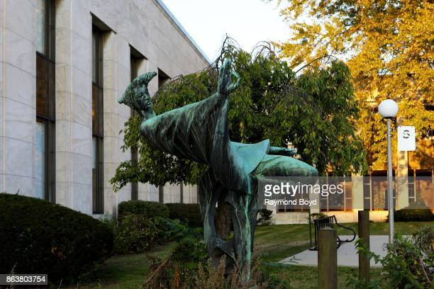 Joseph N DeLauro's 'Exploration' sculpture sits outside the Cass Avenue entrance to the Detroit Public Library in Detroit Michigan on October 13 2017...