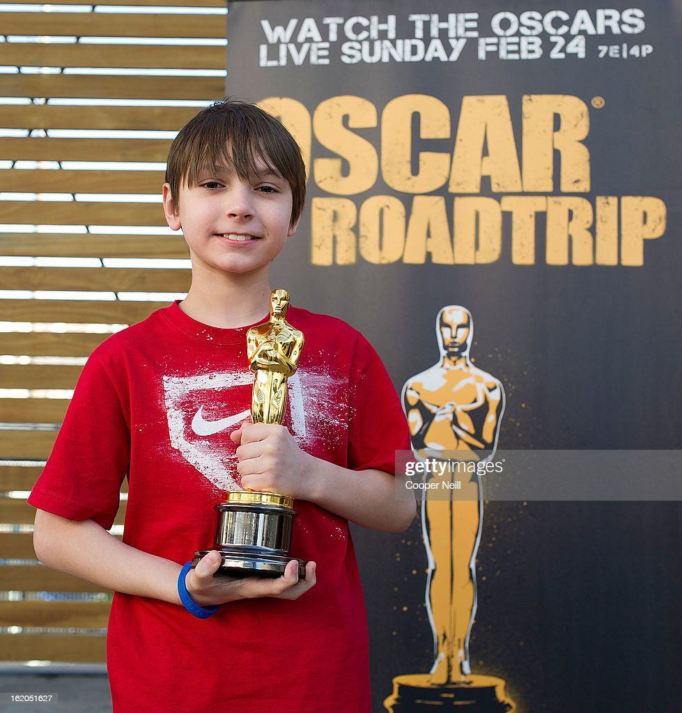 Joseph Nativi poses with an Oscar trophey during First-Ever Oscar Roadtrip at the Angelika Film Center on February 18, 2013 in Dallas.