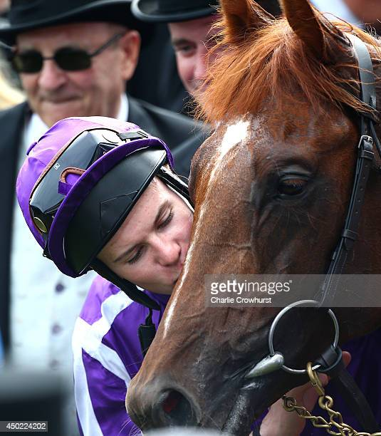 Joseph O'Brien kisses Australia after they win The Investec Derby at Epsom racecourse on June 07 2014 in Epsom England