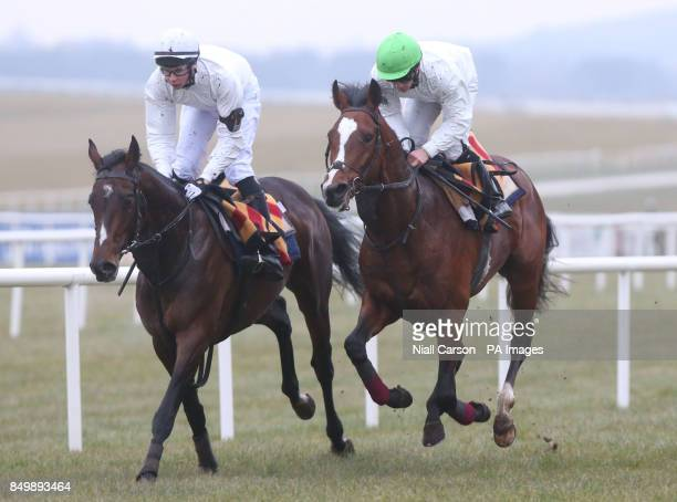 Joseph O'Brien on Camelot and Wayne Lordon on another Horse at Curragh Racecourse County Kildare Ireland