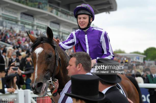 Joseph O'Brien on St Nicholas Abbey celebrates winning the Investec Coronation Cup on the Investec Derby Day at Epsom Downs Racecourse Surrey
