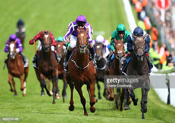 Joseph O'Brien riding Australia celebrates winning The Investec Derby at Epsom racecourse on June 07 2014 in Epsom England