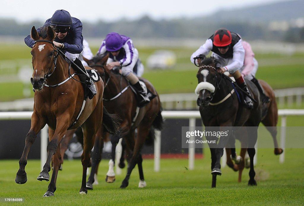 Joseph O'Brien riding Dazzling win The sapphire EBF Fund Fillies' Maiden at Curragh racecourse on September 01 2013 in Kildare Ireland