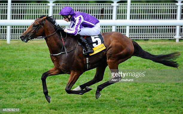 Joseph O'Brien riding Highland Reel to win The Veuve Clicquot Vintage Stakes at Goodwood racecourse on July 30 2014 in Chichester England