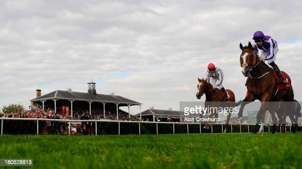 Joseph O'Brien riding Leading Light win The Ladbrokes St Leger at Doncaster racecourse on September 14 2013 in Doncaster England