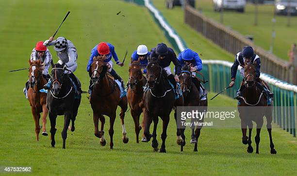 Joseph O'Brien riding Together Forever wins the Dubai Fillies' Mile during The Future Champions Day racing at Newmarket Racecourse on October 17 2014...