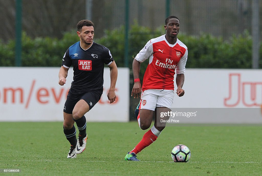 Joseph Olowu of Arsenal under pressure from Mason Bennett of Derby during the match between Arsenal U23 and Derby County U23 at London Colney on January 6, 2017 in St Albans, England.