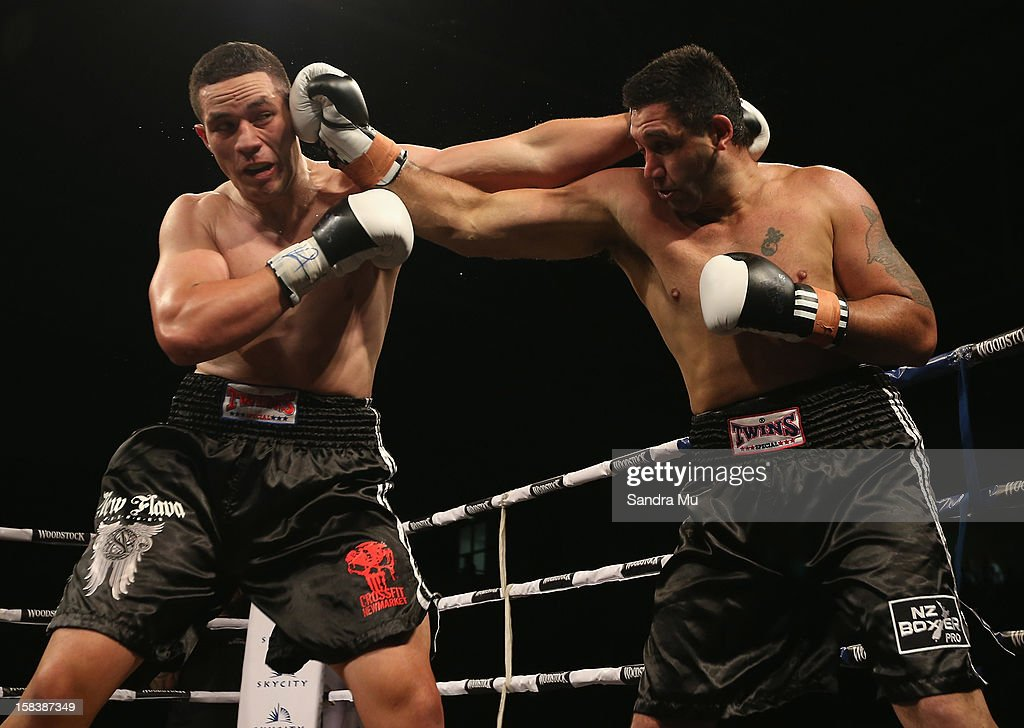 Joseph Parker (L) and Richard Tutaki in action during the professional bout between Joseph Parker and Richard Tutaki during the 2012 Fight for Life at Trusts Stadium on December 15, 2012 in Auckland, New Zealand.